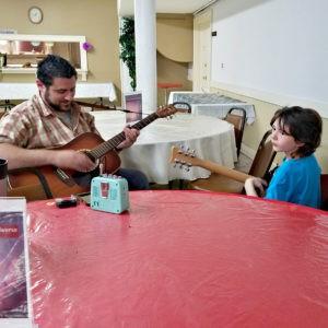 Adam teaching guitar lessons WP
