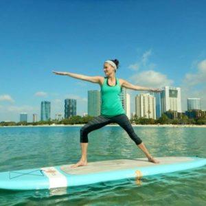 leisure sara doing sup yoga in hawaii