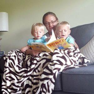 melanie reading to her neice and nephew
